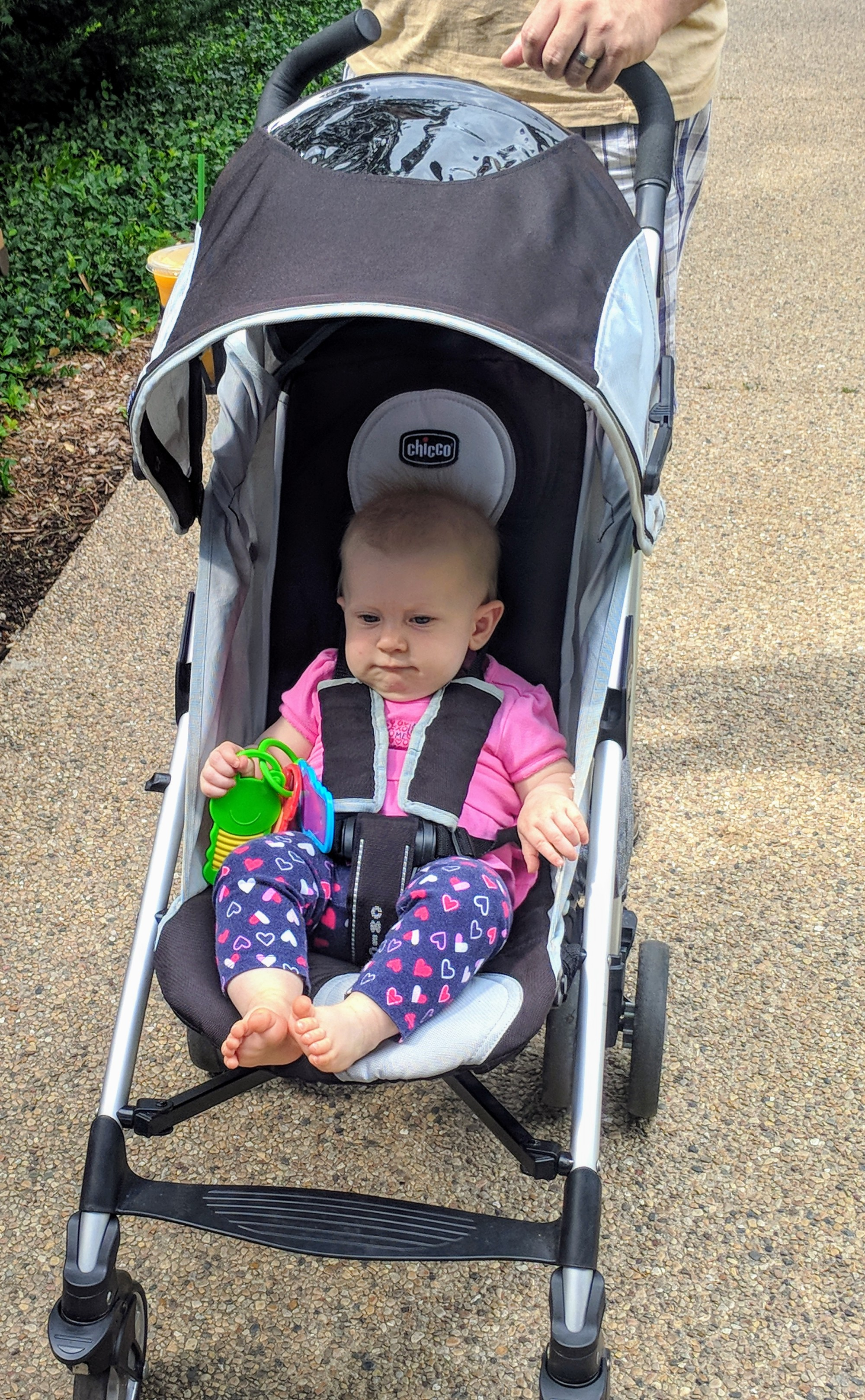 Baby in a lightweight Chicco baby stroller