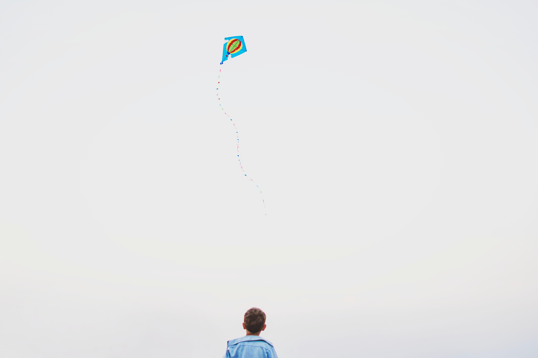 kid flying a kite