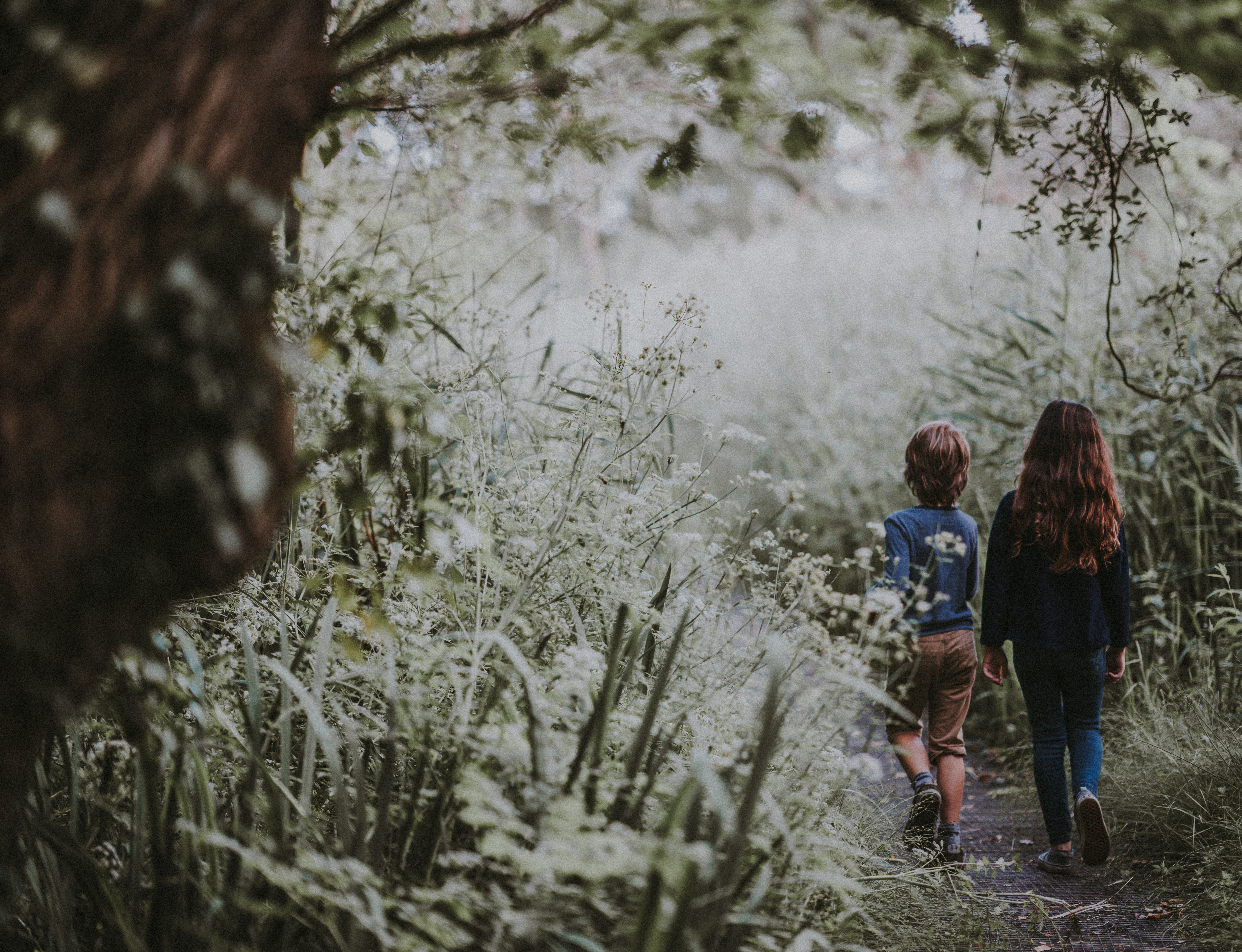 two kids walking in nature
