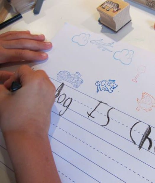 child using stamps