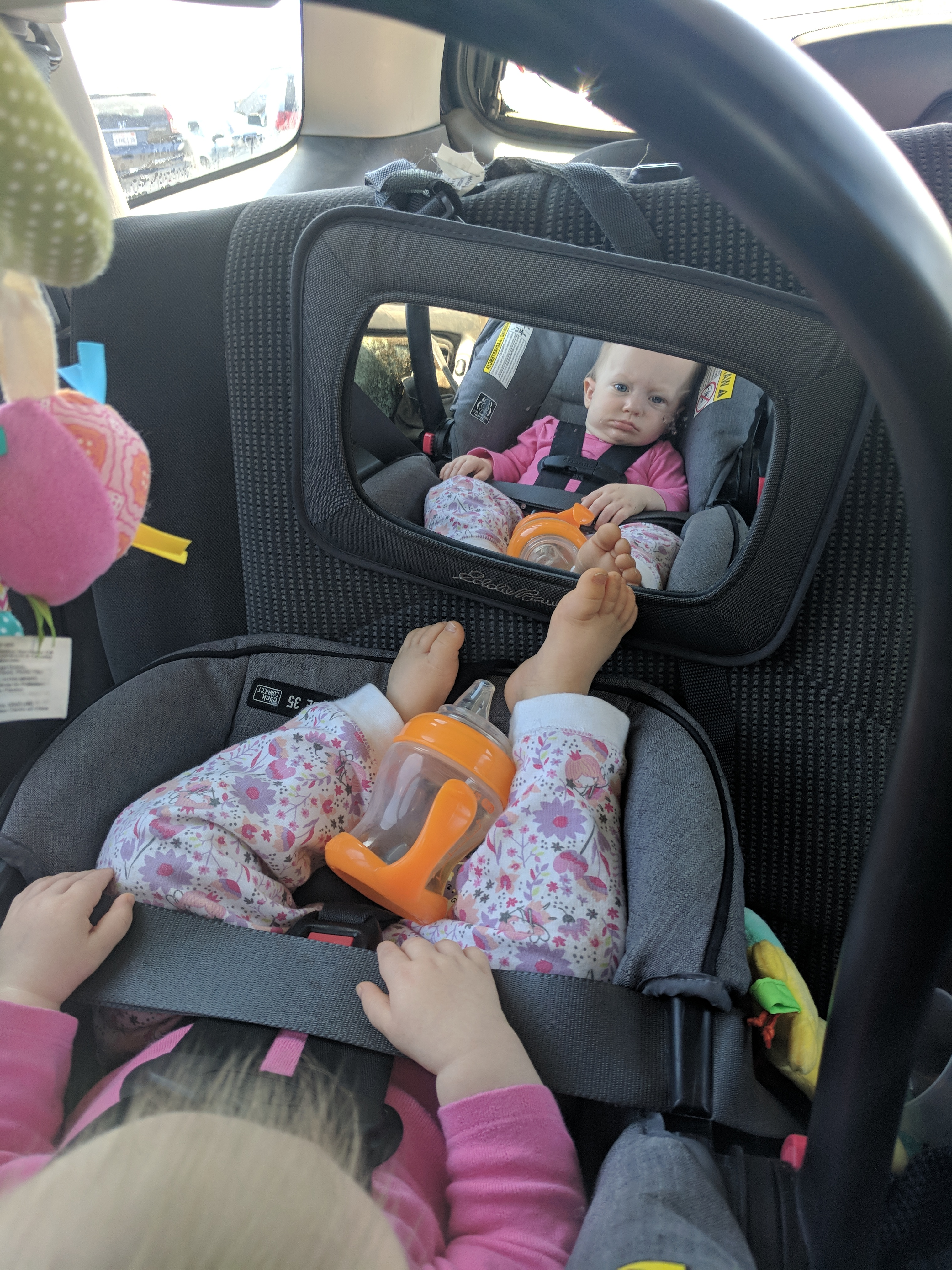 Violet ready to get out of the car seat already