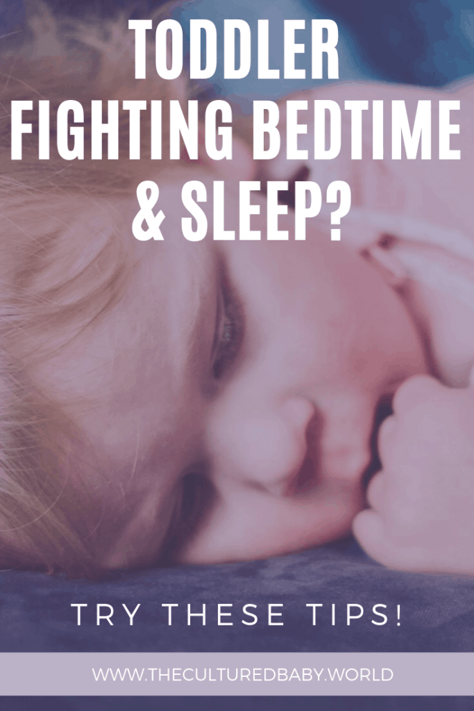 baby laying down awake on the bed | how to get toddler to sleep through the night