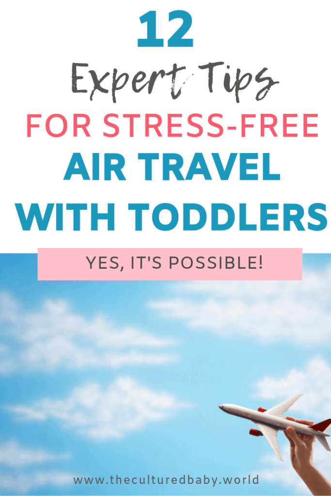 12 expert tips for stress free air travel with toddlers | paper airplane held by a hand in the sky