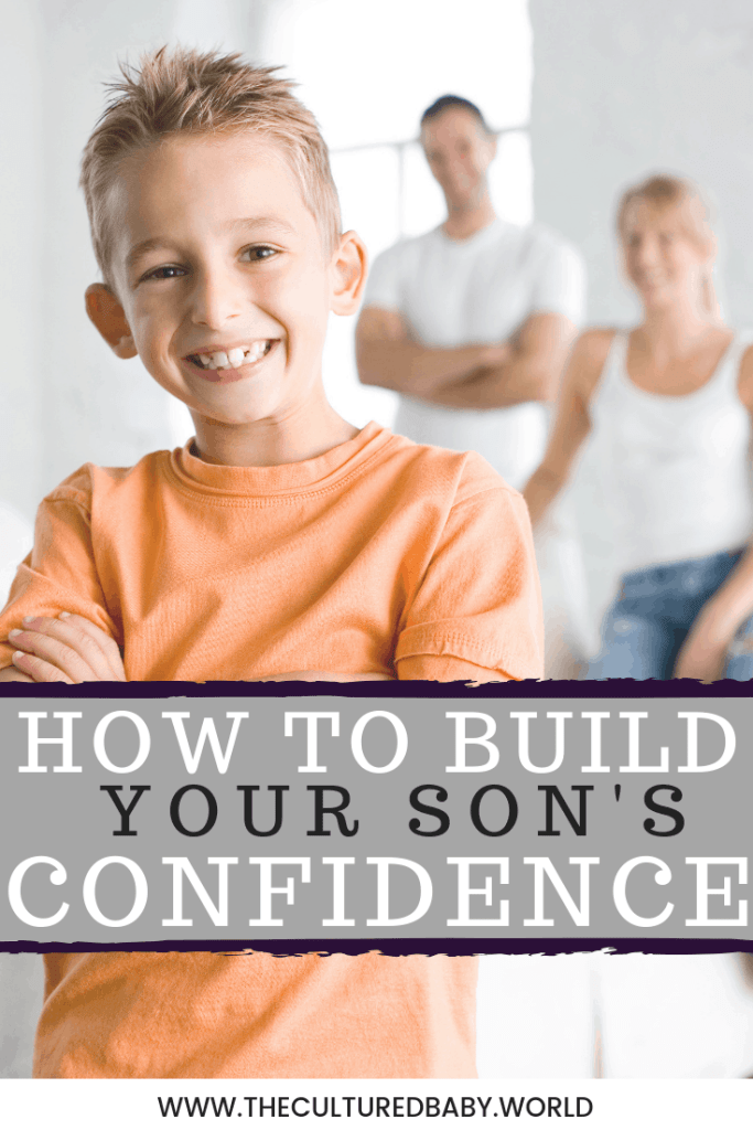 young boy smiling with his parents standing in the background |How to Build Your Son's Confidence