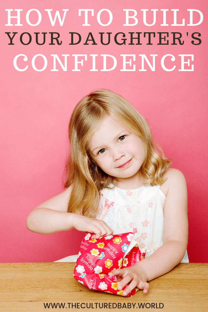 little girl opening a gift |building self-confidence