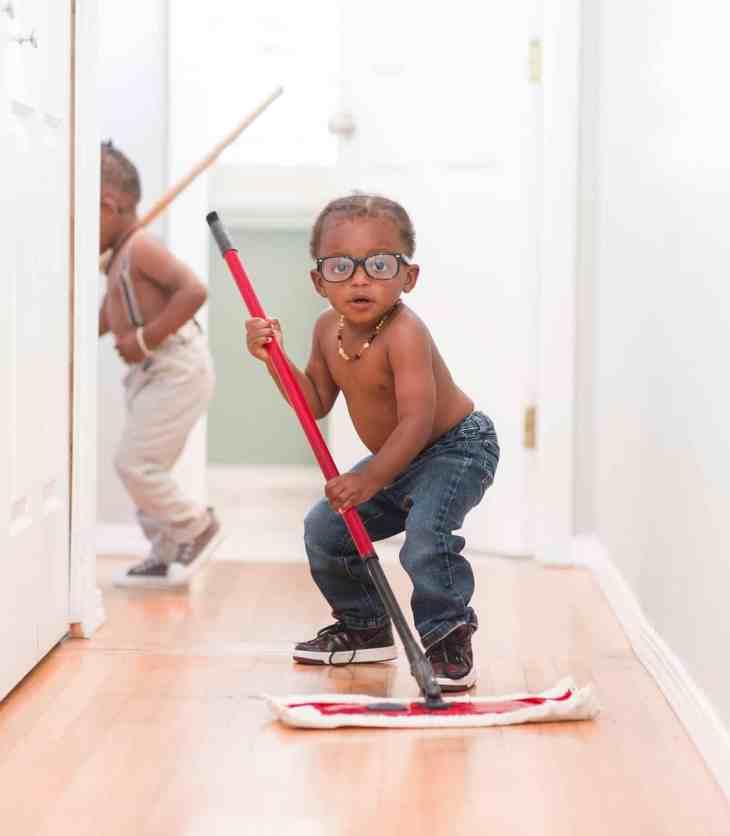 little boy mopping the floor