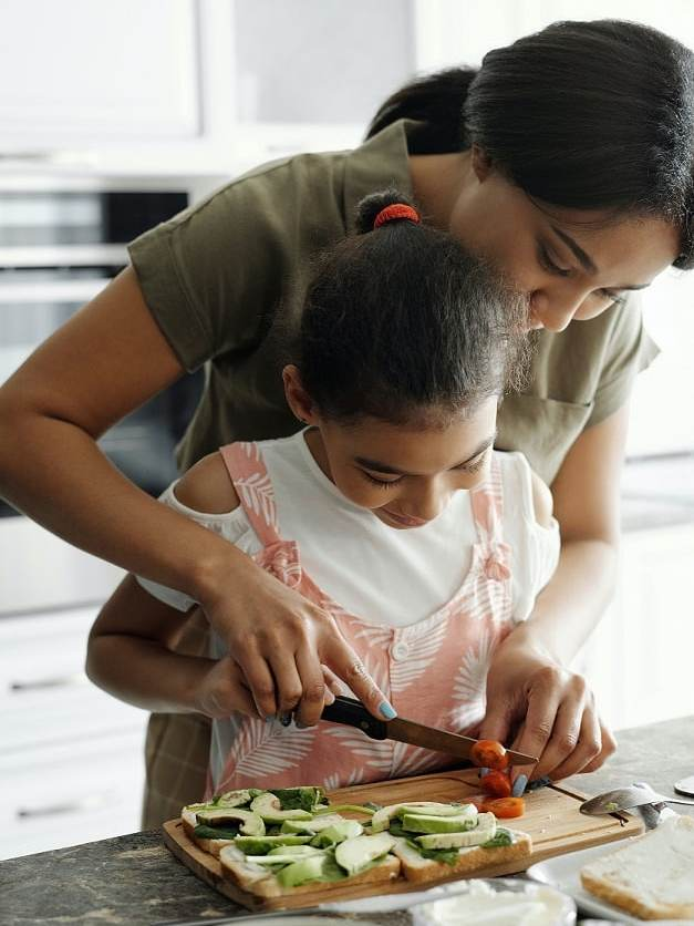 mom cooking in the kitchen with her daughter