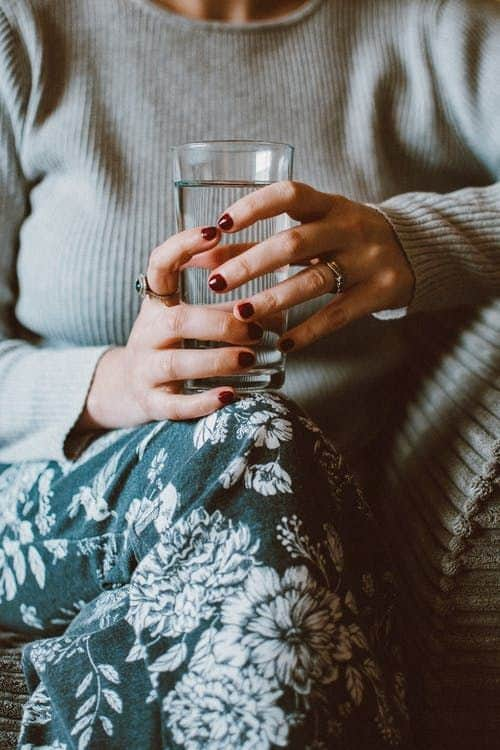 mom drinking a glass of water | sober curious