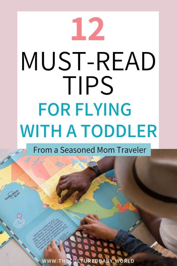 dad and daughter examining a  travel map | tips for flying with a toddler | lap baby