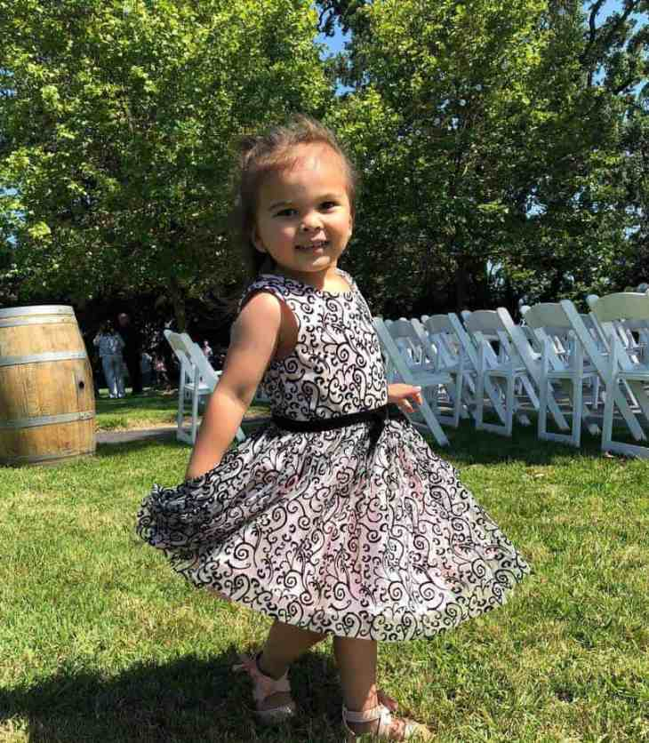 Hawaiian Toddler swirling her dress at a wedding ceremony