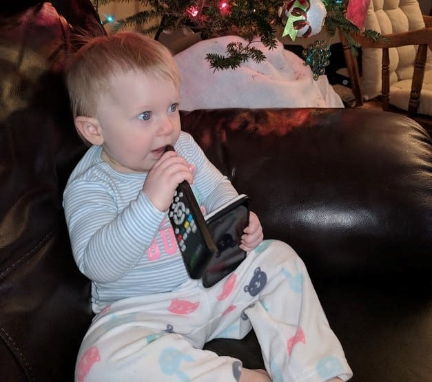 baby playing with remote control